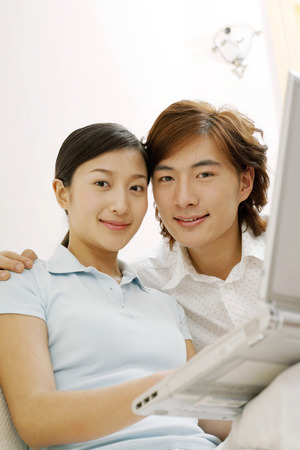 two persons only: Man and woman using laptop together