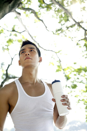lethargy: Man looking away while holding drinking bottle LANG_EVOIMAGES