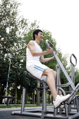full grown: Man exercising in the park