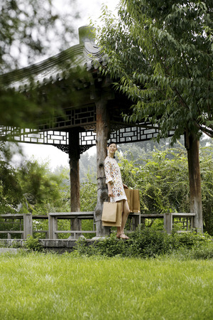 hobby hut: Woman with shopping bags standing by a wooden hut