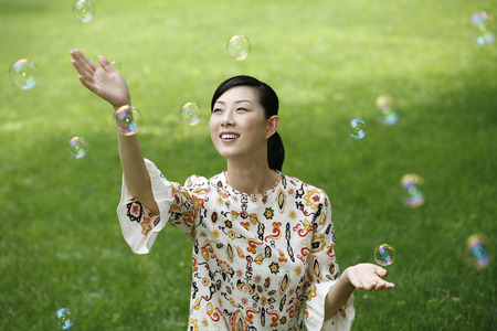 Woman playing with soap bubbles