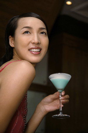 Woman with a glass of cocktail Stock Photo