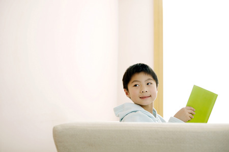living wisdom: Boy sitting on the couch reading book