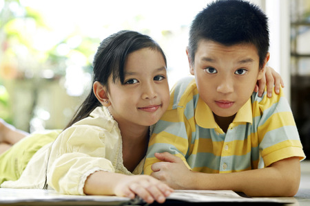 he   my sister: Brother and sister reading magazine together