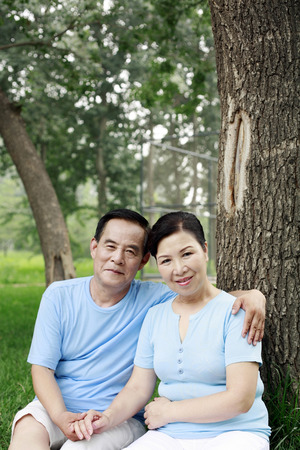 two persons only: Senior man and woman smiling at the camera