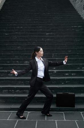 practising: Businesswoman practising tai chi