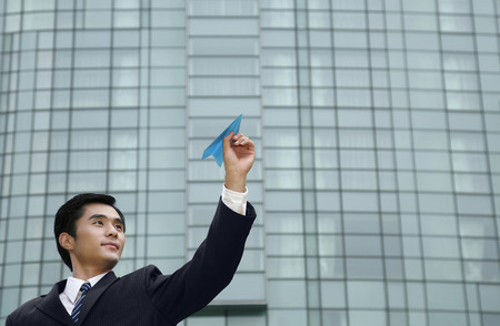 paper plane: Businessman playing with paper plane