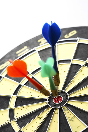 Three darts on bull's eye