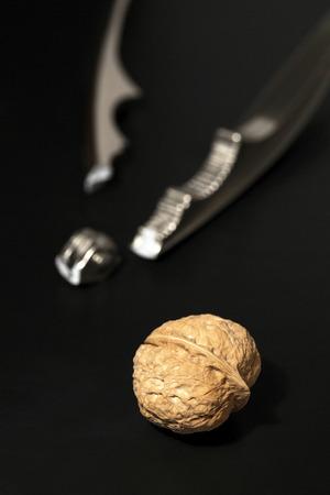 nut cracker: Broken nut cracker and walnut