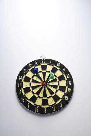 bulls eye: Three darts on bulls eye LANG_EVOIMAGES