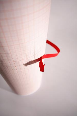 graph paper: Red arrow against graph paper LANG_EVOIMAGES