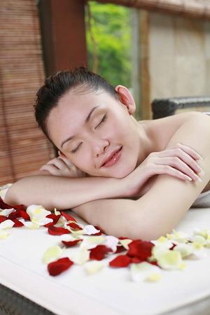 lying forward: Woman lying forward, resting chin on arms
