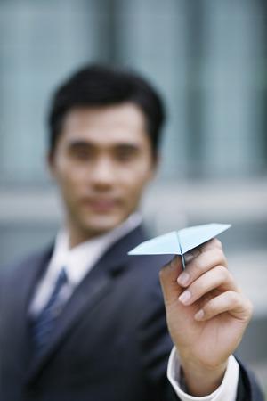 paper plane: Businessman with paper plane
