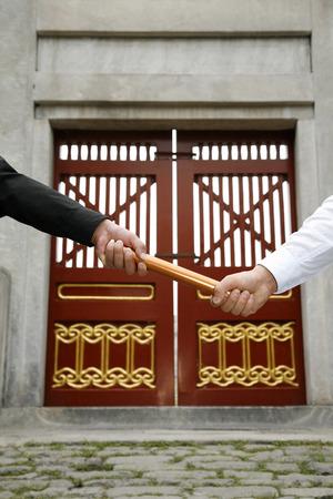 baton: Businessmen passing baton