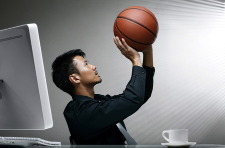 Businessman trying to shoot a basketball