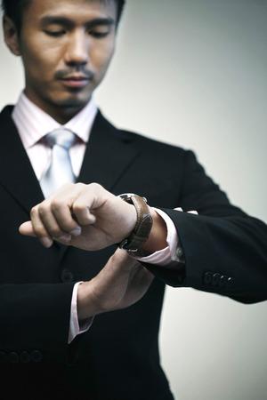 check ups: Businessman looking at his watch