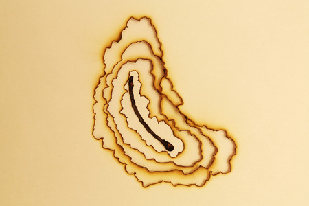 burnt: Burnt match through paper