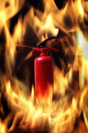 no fires: Fire extinguisher among blazing flames