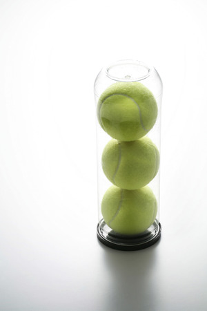 Tennis balls in a container