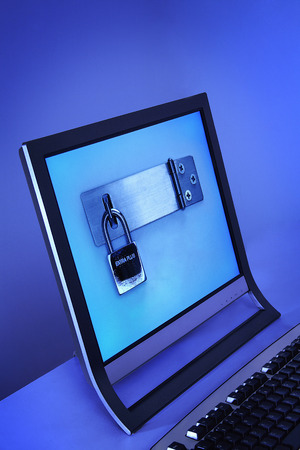 flat screen monitor: Picture of padlock on a flat screen monitor LANG_EVOIMAGES