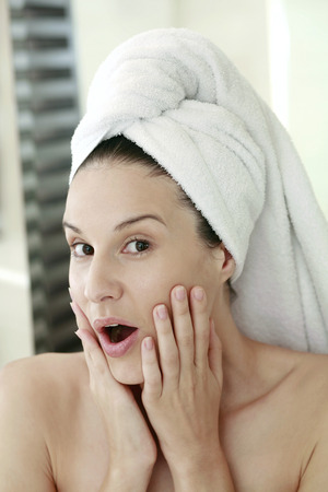 towel wrapped: Woman with towel wrapped hair showing shock expression