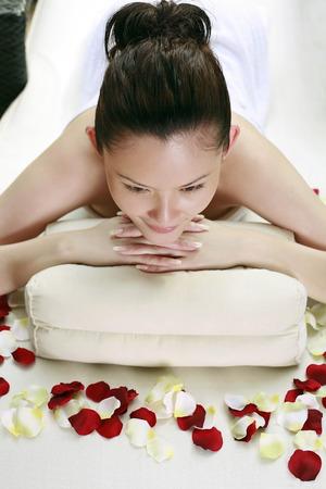 lying forward: Woman lying forward, resting on head pillow
