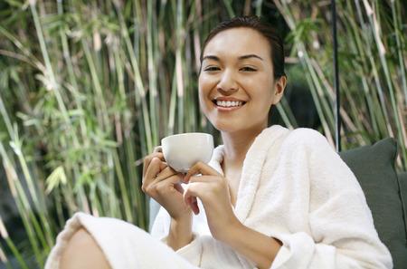 woman bathrobe: Woman in bathrobe enjoying tea