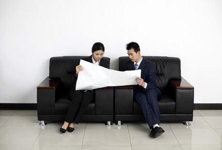 two persons only: Businessman and businesswoman looking at plan LANG_EVOIMAGES