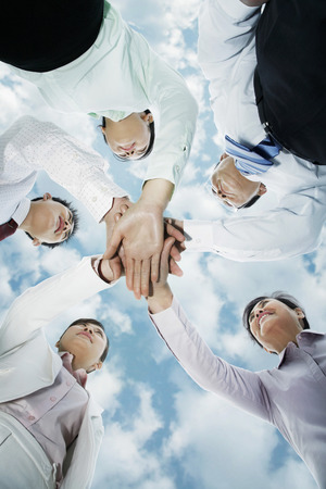 huddling: Business team huddling, hands together