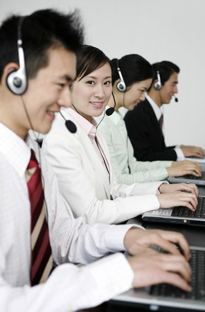 telephone headset: Business people with telephone headset using laptop