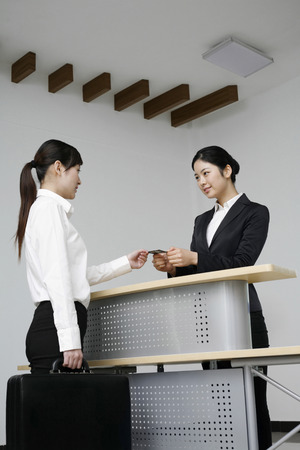 businesswoman card: Businesswoman giving out her business card