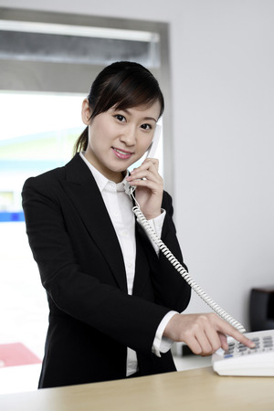 answering: Receptionist answering call
