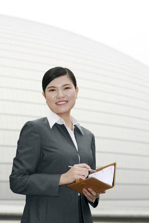 Businesswoman holding an appointment diary