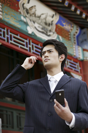 palmtop: Businessman using palmtop LANG_EVOIMAGES