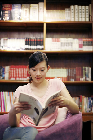 reference book: Female student in the library