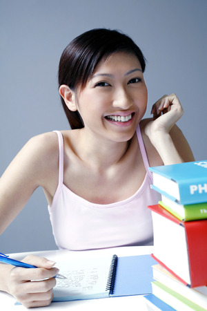 college life: Female student smiling at the camera