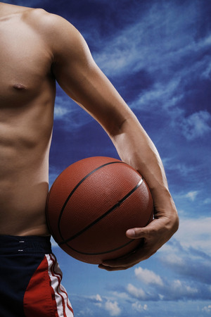 bare chested: Man with basketball LANG_EVOIMAGES