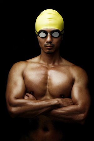 swimming cap: Man in swimming cap and goggles LANG_EVOIMAGES