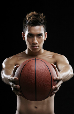 bare waist: Man with basketball staring at the camera