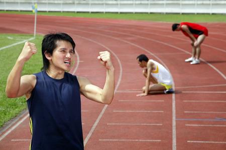 gritting: Man winning a race