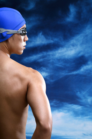 bare waist: Man with swimming cap and goggles looking away