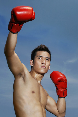 bare waist: Man with red boxing gloves LANG_EVOIMAGES