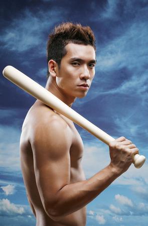 Man posing with baseball bat