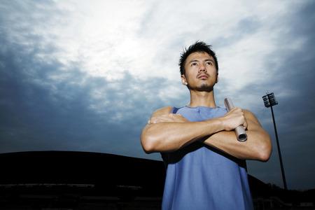 sportsmanship: Man holding baton