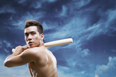 bare chested: Man playing baseball