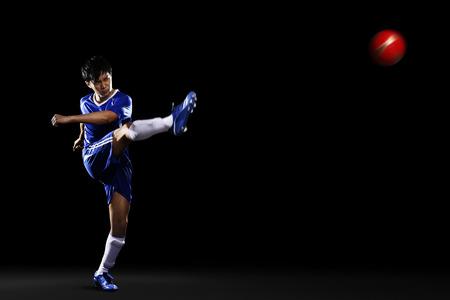 kicking ball: Man kicking ball