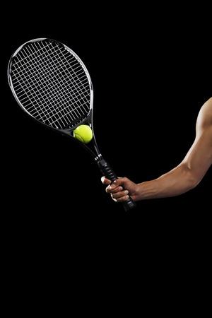 tennis racquet: Man with tennis racquet and tennis ball LANG_EVOIMAGES