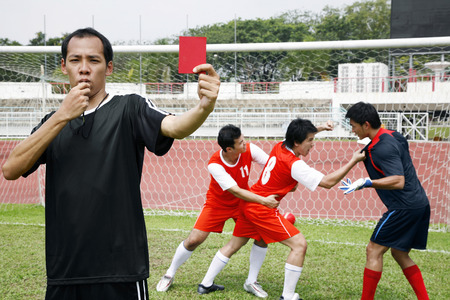 Man showing red card