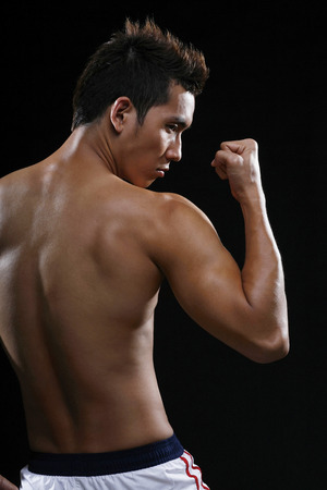 bare chested: Man flexing muscles LANG_EVOIMAGES