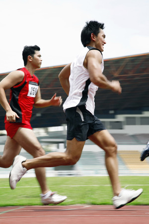 two persons only: Men running in a race LANG_EVOIMAGES